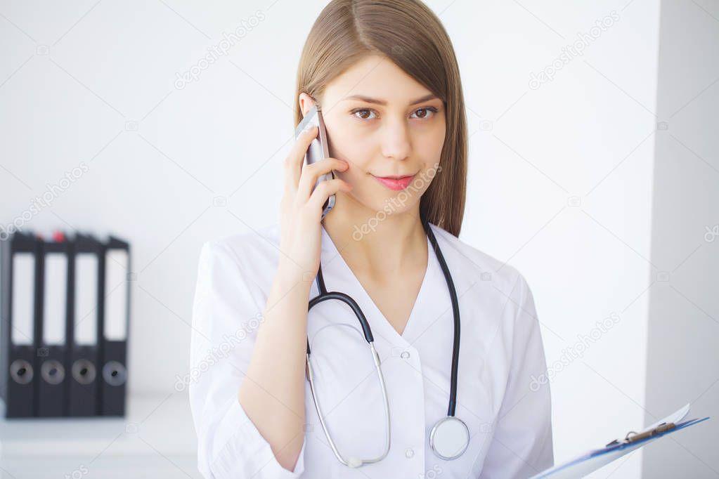https://st4.depositphotos.com/1079673/26069/i/950/depositphotos_260694400-stock-photo-medicine-young-female-doctor-in.jpg